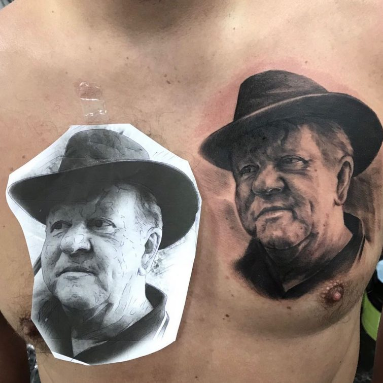 Portrait Face Tattoo at Chest