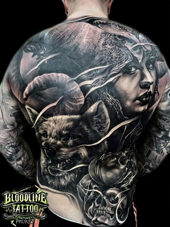 Realistic Wolf and Skull Design at Back