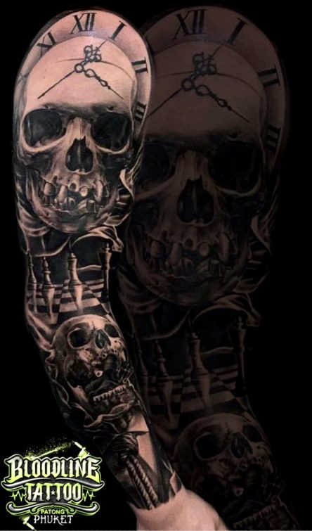 Realistic Skull Tattoo Design on Arms